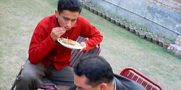 Student eating in a class function